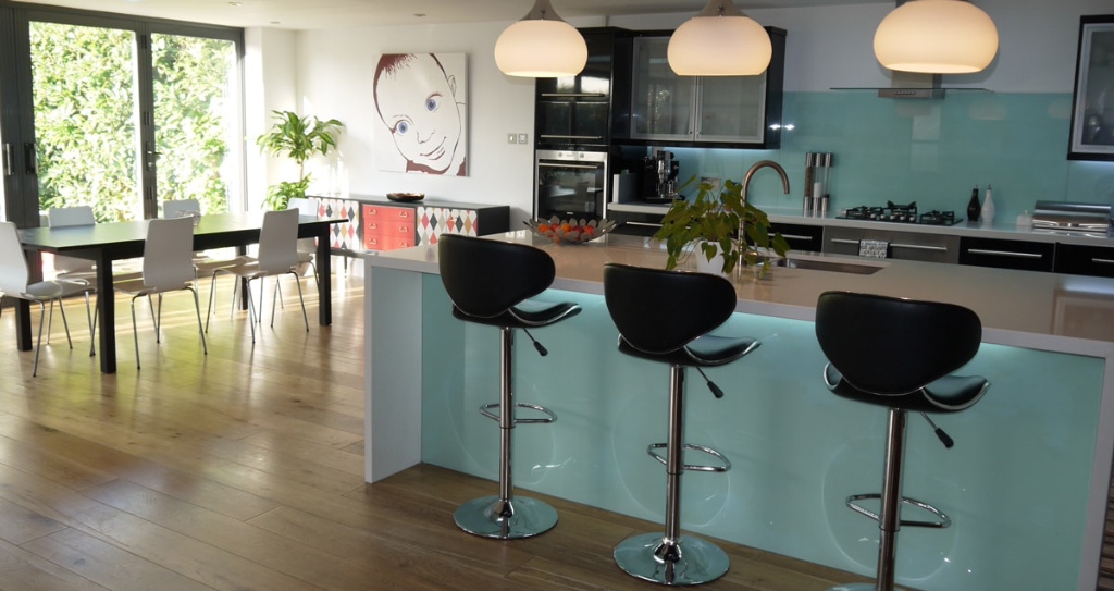 black kitchen, blue splash back