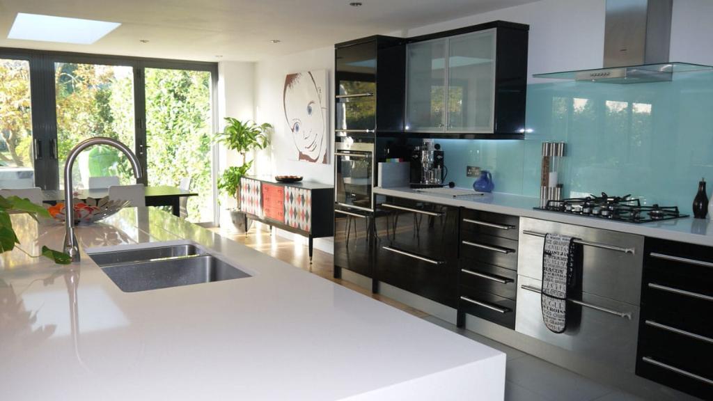 black kitchen, blue splash back