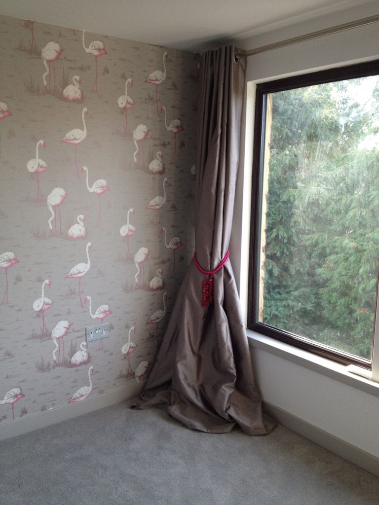 curtains, pink beaded tie-backs, flamingo wallpaper