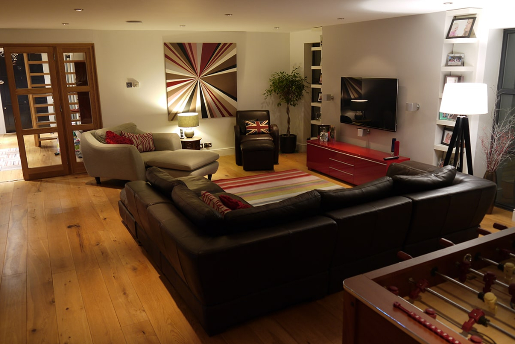 Open plan lounge, red TV unit