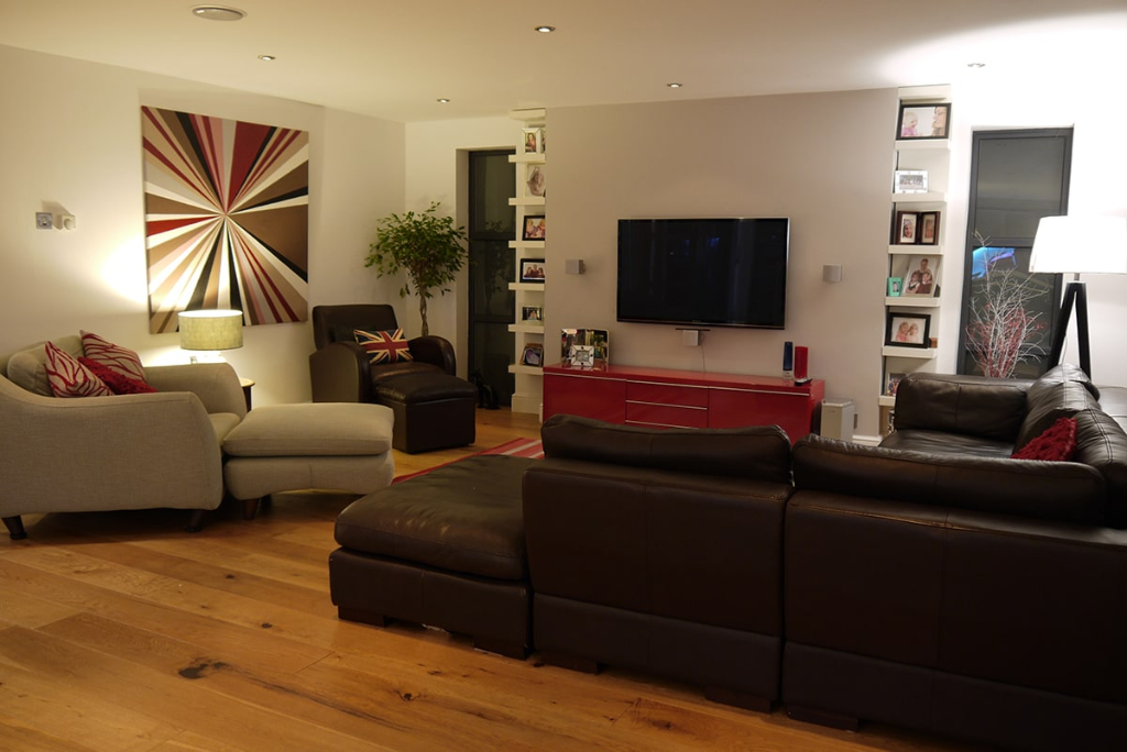 Open plan lounge, large canvas painting, red TV unit