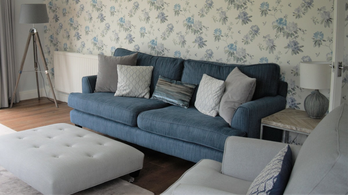 Calm grey living room, blue sofa