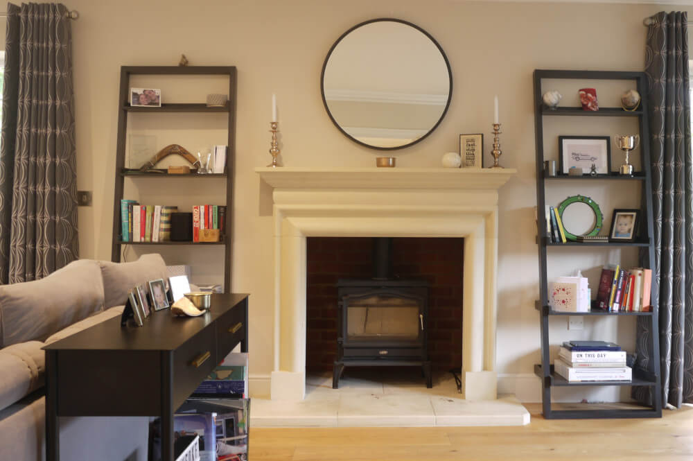 Contemporary Living Room Weybridge with fireplace in centre of the room, layout design