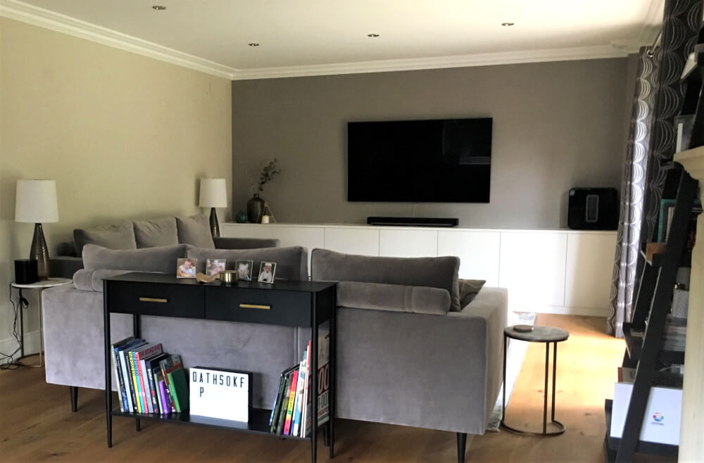 Contemporary Living Room Weybridge with wallpapered feature wall, bespoke fitted unit and grey velvet sofas
