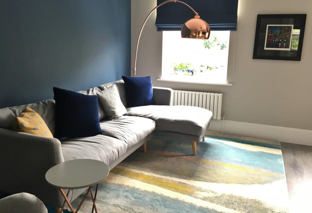 Colourful Scandinavian Living Room Surbiton with Blue and Grey colour scheme, blue blinds and copper floorlamp