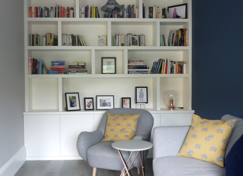 Colourful Scandinavian Living room with bespoke bookcase, grey and blue colour scheme and yellow accent